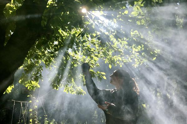 Woman holding mate up in the morning light of Estancia Ranquilco garden