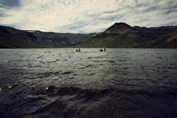 Swimming with horses in an alpine lake in Argentina
