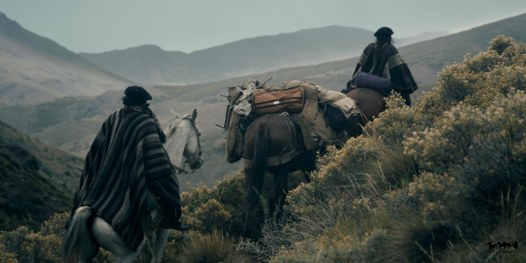 Two gauchos horse packing in the mountains of Patagonia Argentina at Estancia Ranquilco