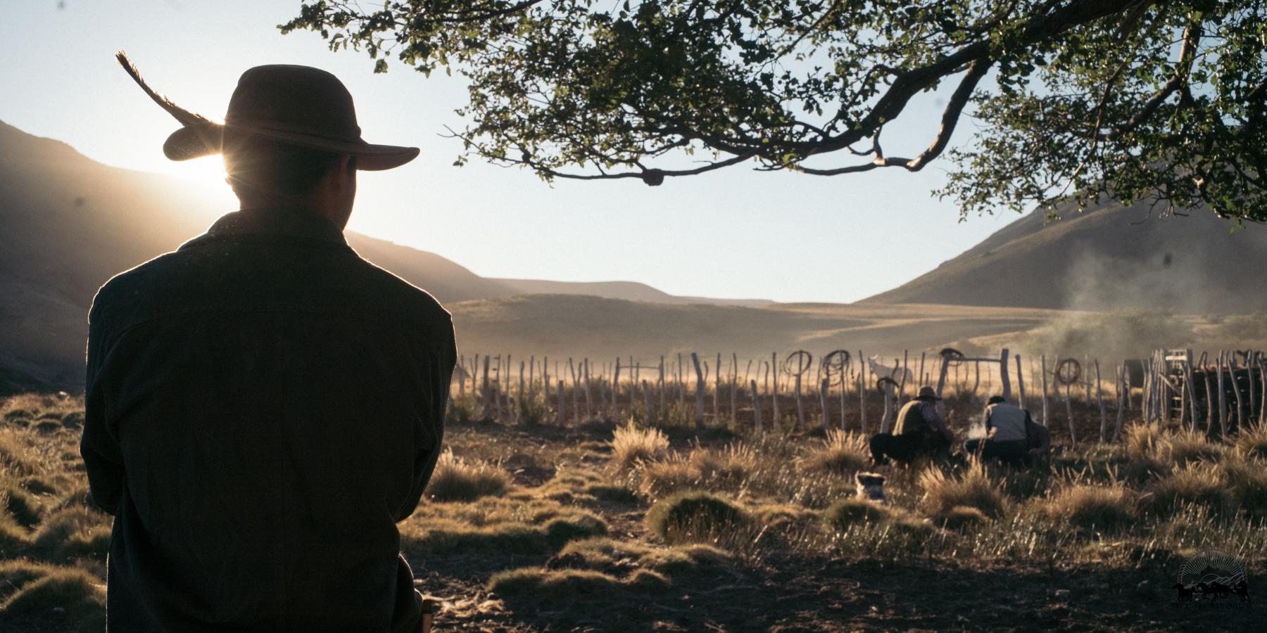 Silhouette of man watching gauchos at Estancia Ranquilco in Argentina