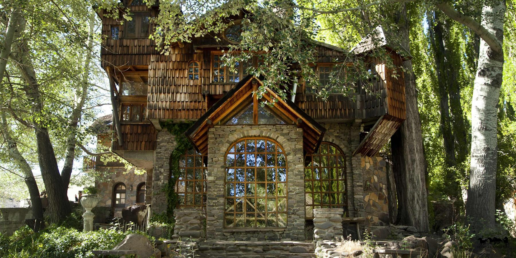Estancia Ranquilco's wood and stone guest lodge in the trees in Patagonia Argentina