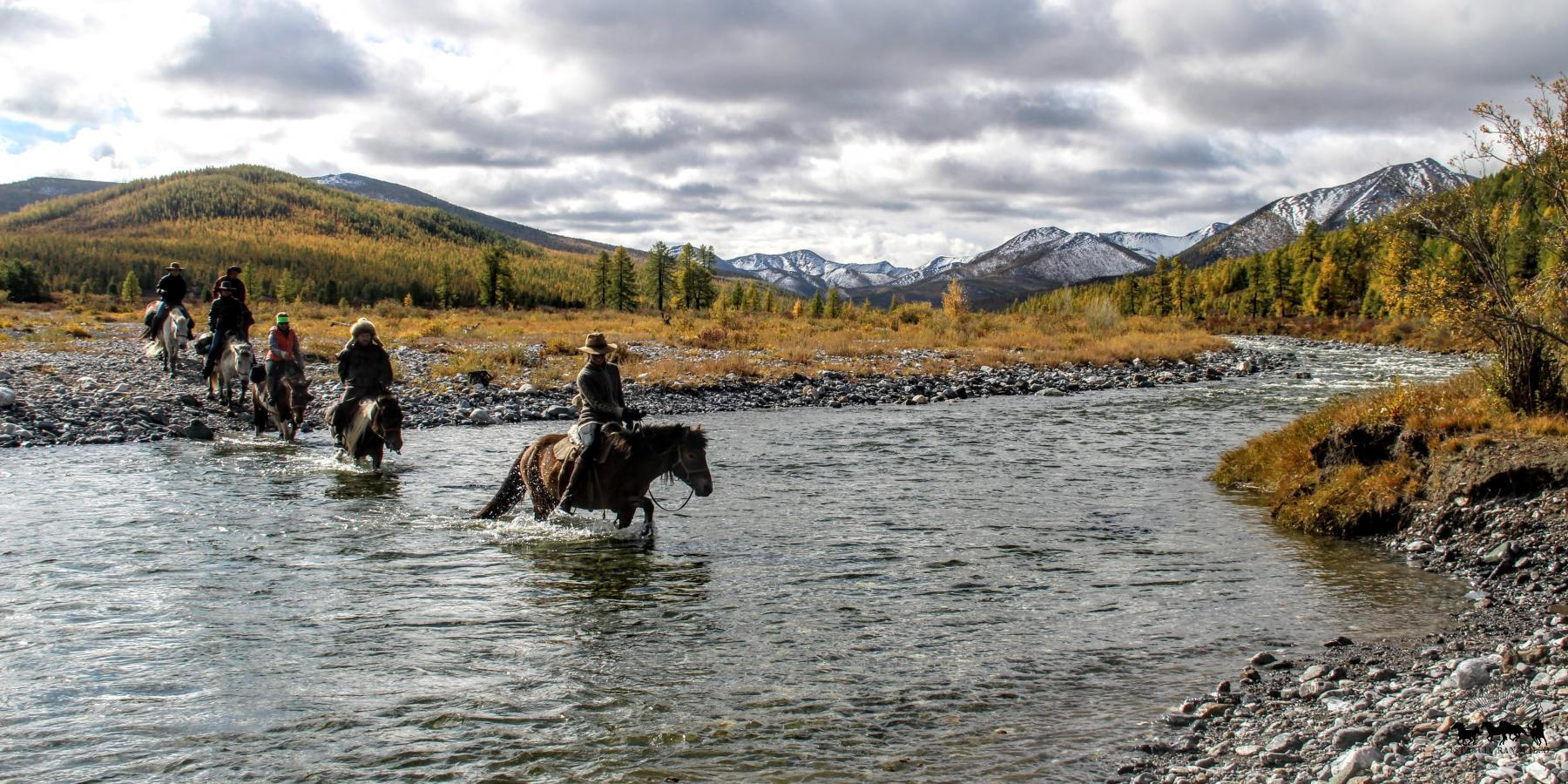 Crossing the river while horse trekking through northern Mongolia with Estancia Ranquilco