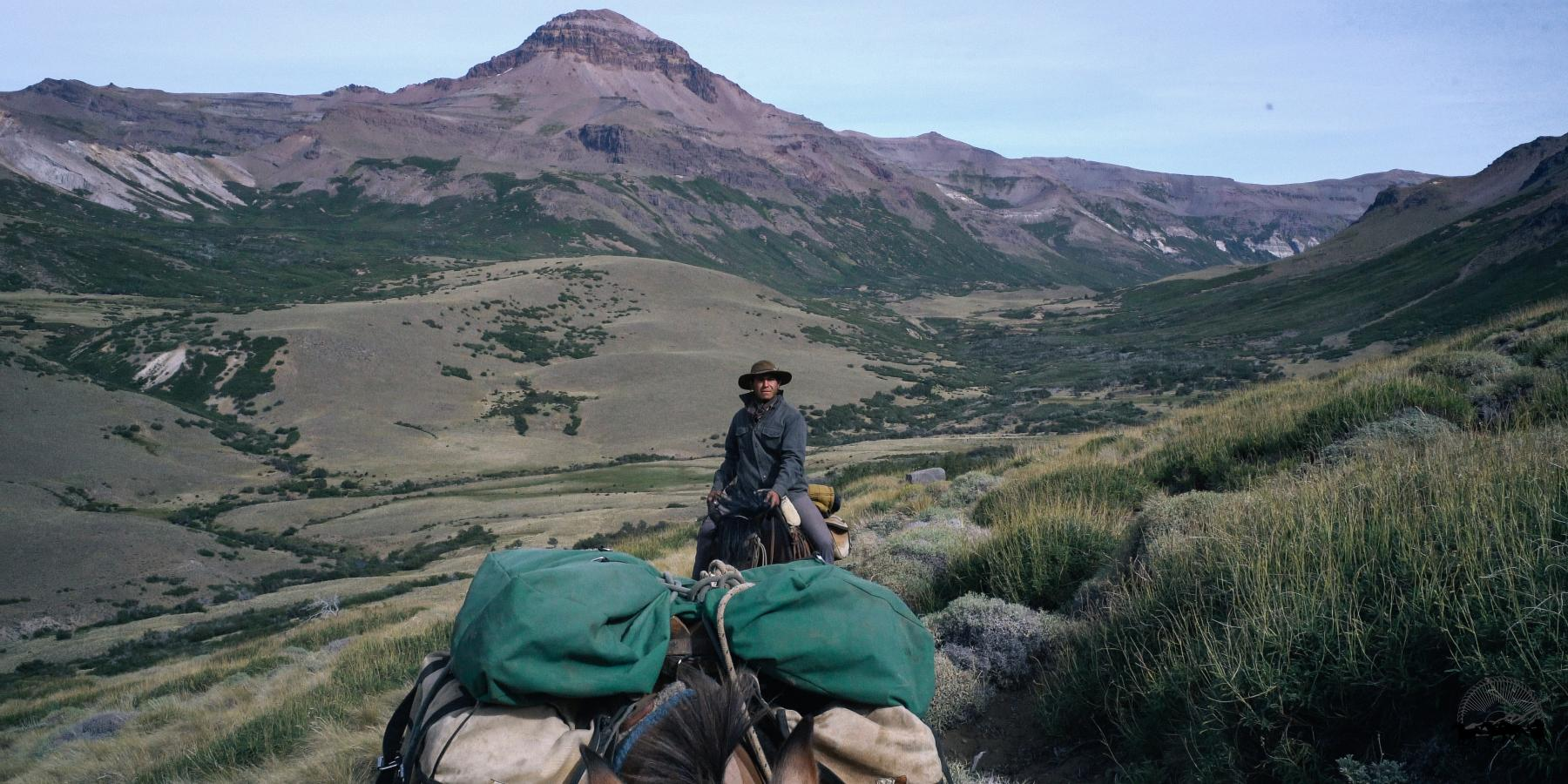 Man riding in the Andes with a pack mule on an Estancia Ranquilco pack trip