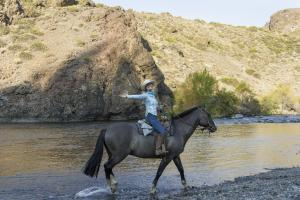Crossing the river on a riding vacation in Argentina