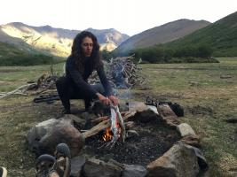 Horse guide making a fire on a pack trip in Argentina
