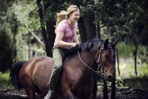 Woman riding horse bareback at Estancia Ranquilco in Patagonia