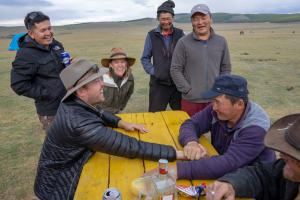 Guests and Mongolian guides arm wrestling during an Estancia Ranquilco pack trip