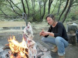 Woman preparing an asado on a horsepack trip with Estancia Ranquilco in Patagonia Argentina