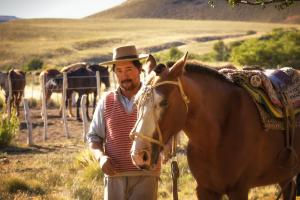 Gaucho with his Argentine criollo horse in Patagonia Argentina