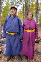 Husband and wife Tsaatan people posing together in the taiga forest