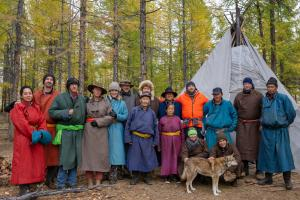 Estancia Ranquilco guests standing with Tsaatan reindeer people in front of their teepee in northern Mongolia