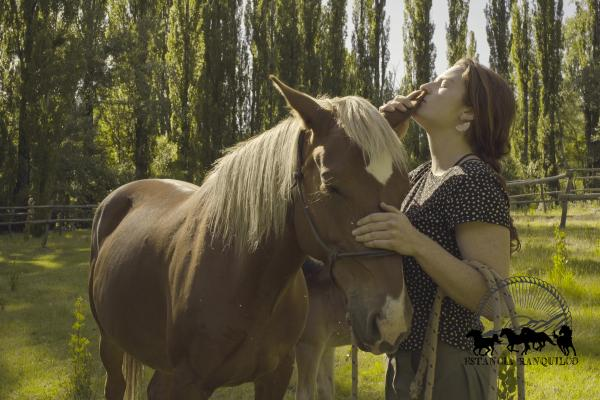Woman and criollo horse on ranch in Patagonia Argentina