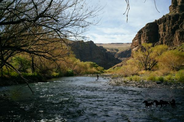 Woman fly fishing at Estancia Ranquilco in Patagonia Argentina